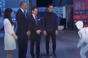 President Obama plays soccer with robot, needs to work on his touch